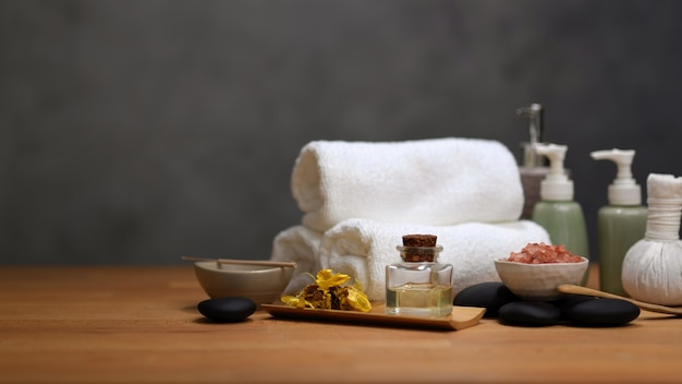 Cropped shot of spa table with spa accessories and copy space on wooden table, spa therapy concept