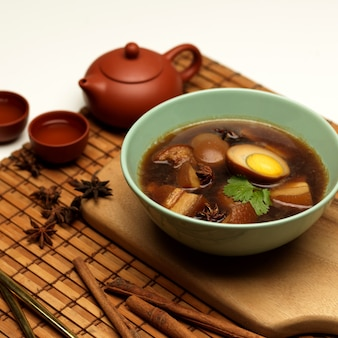 Cropped shot of sweet brown stewed eggs soup kai palo