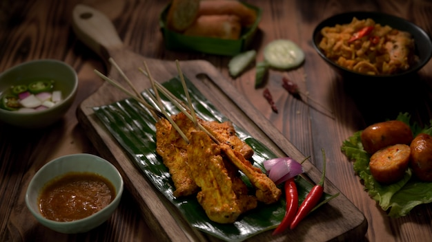 Cropped shot of thai traditional street food with pork satay with peanut sauce