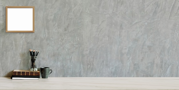 Cropped shot of trendy workplace with copy space and office supplies on marble background and loft grey wall