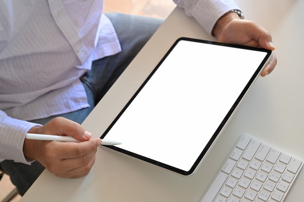 Cropped shot of an unrecognizable man using a tablet.