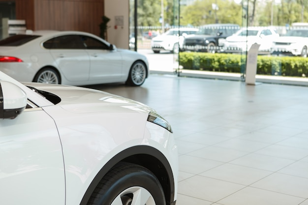 Cropped shot of white car for sale at dealership salon, copy space