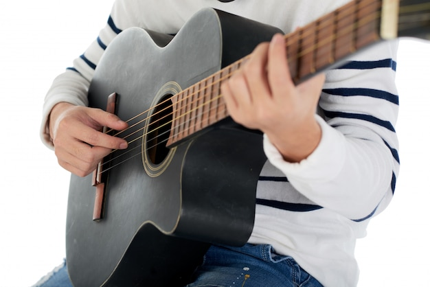 Cropped unrecognizable man playing the acoustic guitar