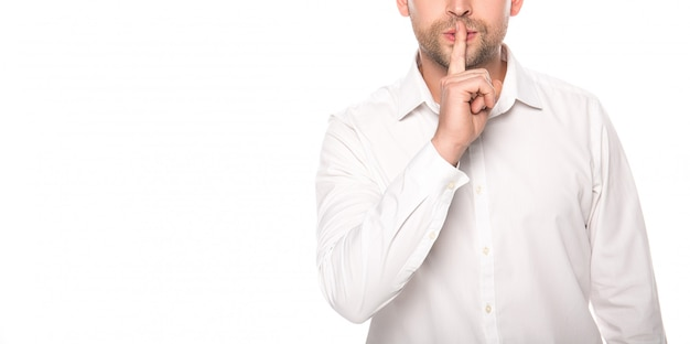 Cropped view of businessman showing okay shh isolated on white
