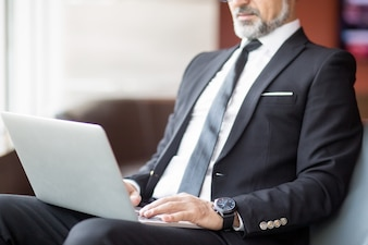 Cropped View of Business Man Using Tablet