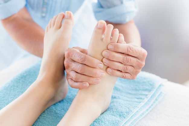 Cropped woman receiving foot massage