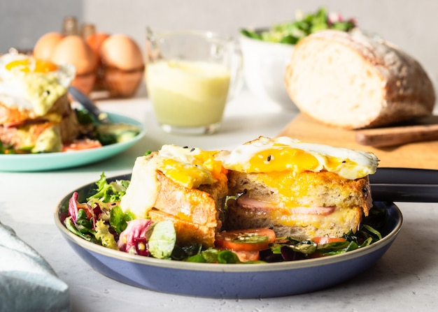 Croque madame with ham, melted emmental, fried egg and bechamel.