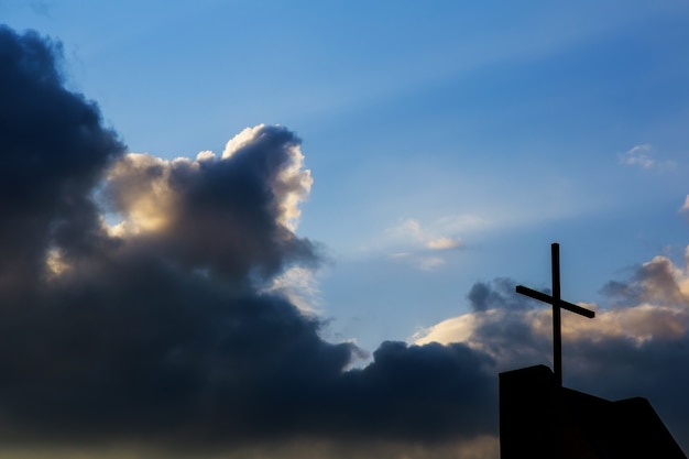 Cross against the sky background. religious concept