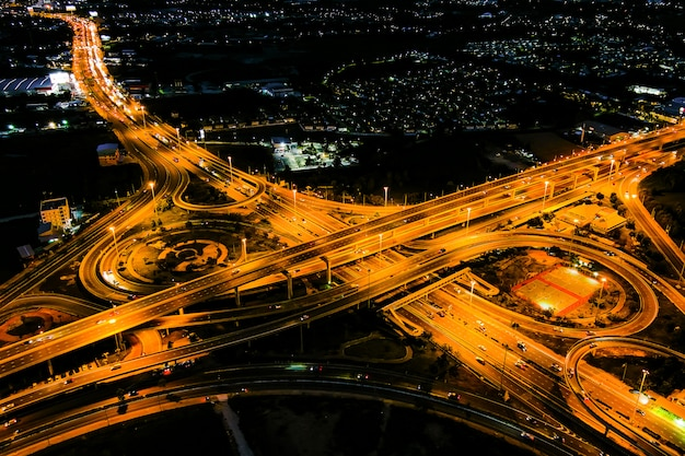 Cross motorway traffic junction road into the city at night