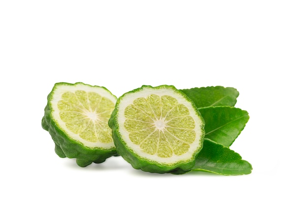 Cross section or a half bergamot or kaffir on white isolated background with clipping path.