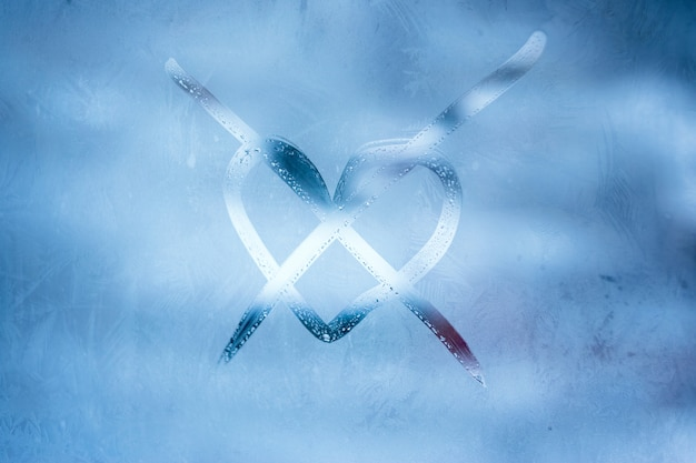 Crossed heart handwritten symbol