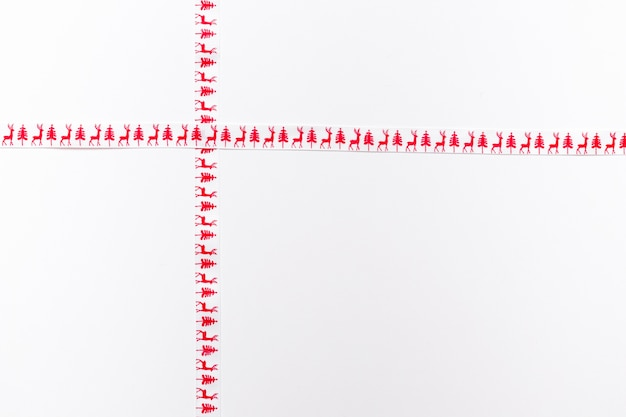Crossed patterned ribbons isolated on white
