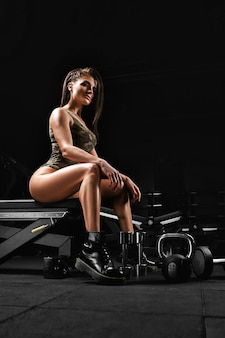 Crossfit concept, young partnering girl, crossfit model, in clothes for aggressive training. fitness banner, copy space. all or nothing, blood sweat tears.