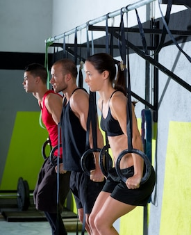 Crossfit dip ring group workout dipping in a row
