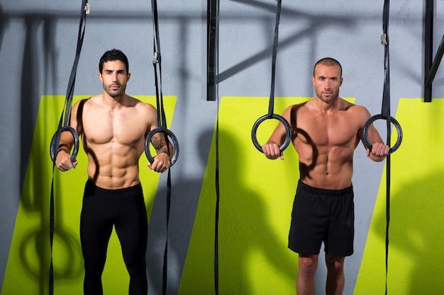 Crossfit dip ring two men workout at gym