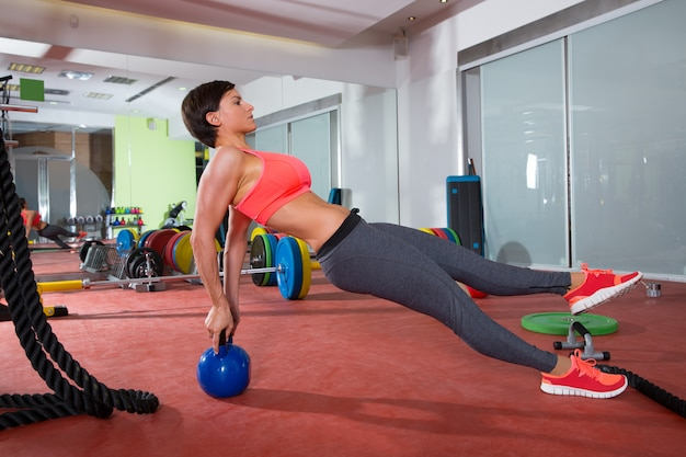 Crossfit fitness woman push ups kettlebell pushup exercise