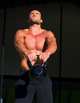 Crossfit kettlebells swing exercise man workout