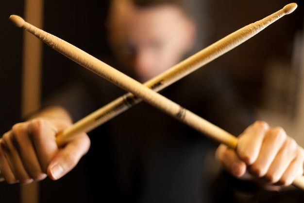 Crossing two drumsticks
