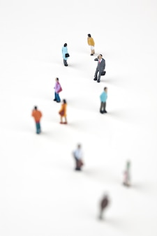 Crowd of miniature people in the city