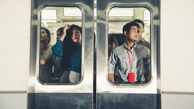 Crowd of people on a busy crowded public subway train travel