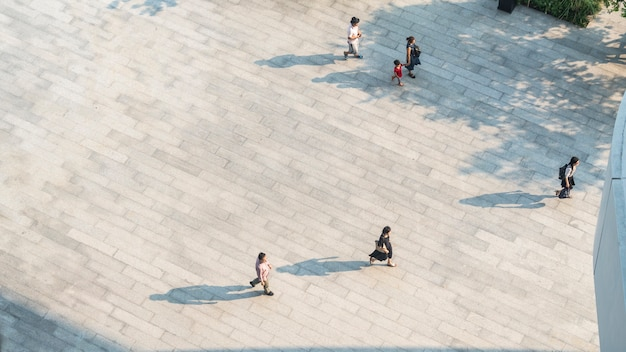 Crowd of people walk on open space pavement from top view ,bird eye view