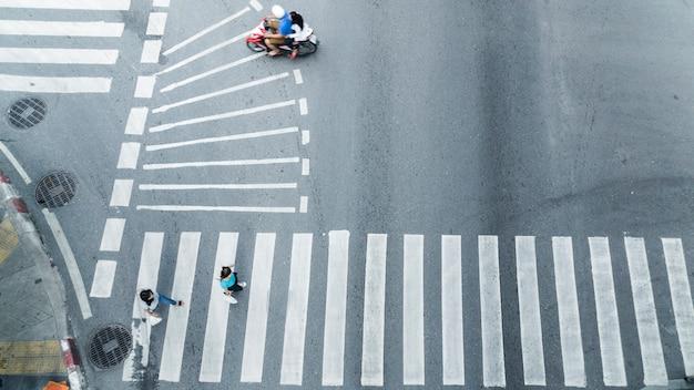Crowd of people walk on street pedestrian crossroad from top view ,bird eye view.