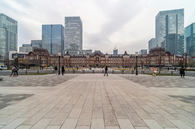 Crowd undefined people visiting and enjoying at tokyo station and marunouchi with car traffic tokyo