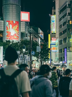 Crowded street at night in the city with people