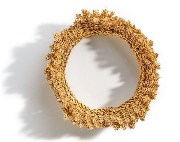 Crown made of wheat ears of cereals isolated on white background top view