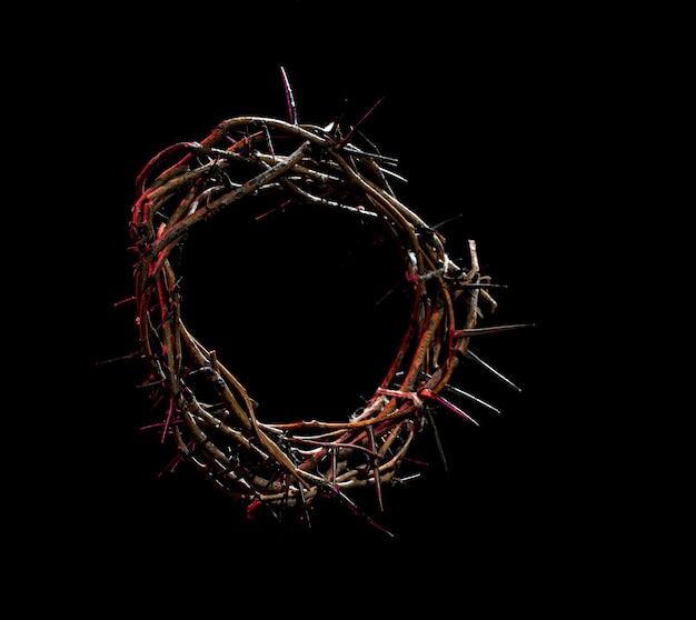 Crown of thorns with a red tint of light in the dark. the concept of holy week, suffering and crucifixion of jesus.
