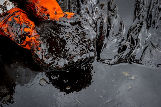 Crude oil along the beach of ao phrao after a nearby oil spill in gulf of thailand.