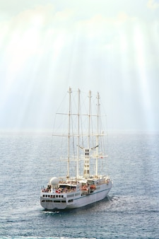 Cruise sailing vessel at the sea in sunshine