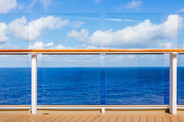 Cruise ship deck and railing with ocean view and copy space