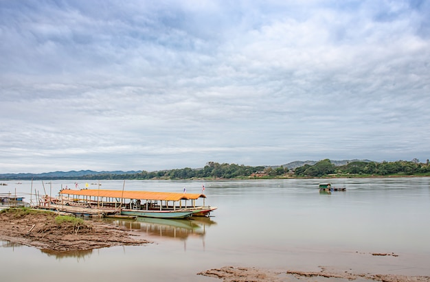 The cruise ship and floating fishing on the mekong river at loei in thailand.
