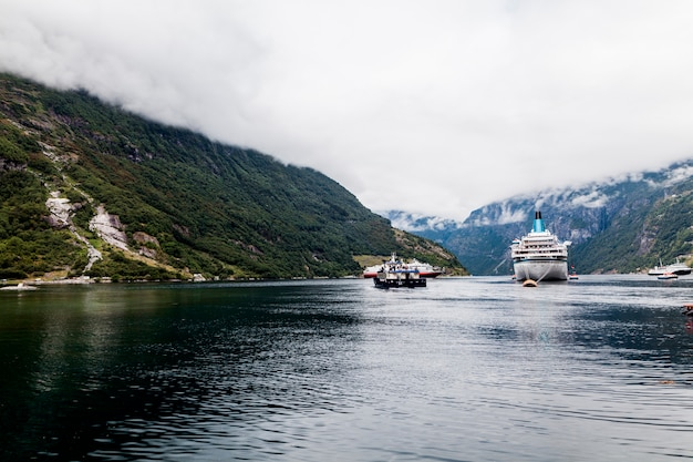 Cruise ship on sea with mountains