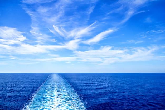 Cruise ship trail on ocean surface