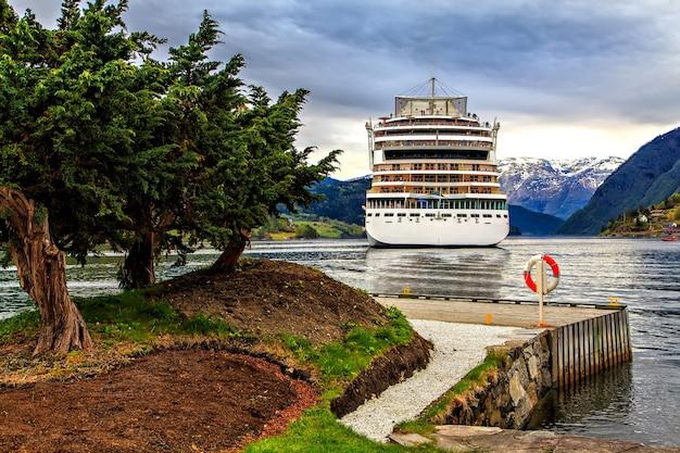 Cruise white liner on fjords background