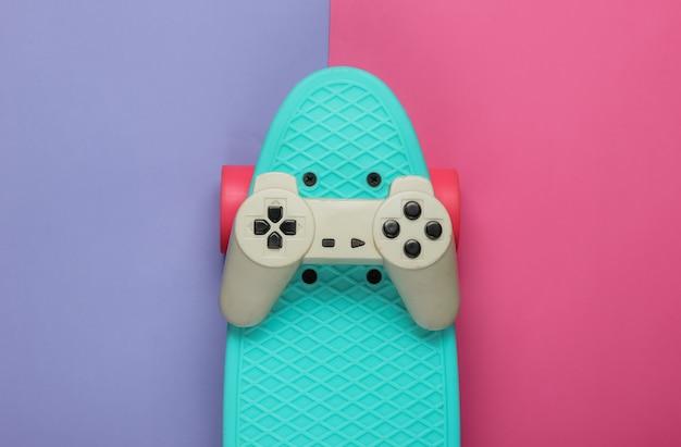 Cruiser board, gamepad on colored paper