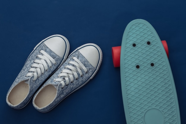 Cruiser board with sneakers on a classic blue. youth entertainment