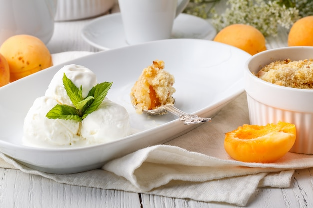Crumble apricot pie on white table, morning dessert