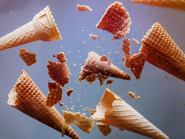 Crumbled ice cream cones on glass.