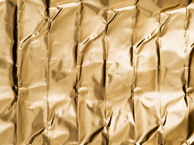 Crumpled abstract shapes of gold