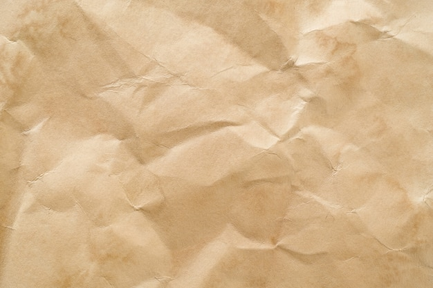 Crumpled beige craft paper background. space for text.