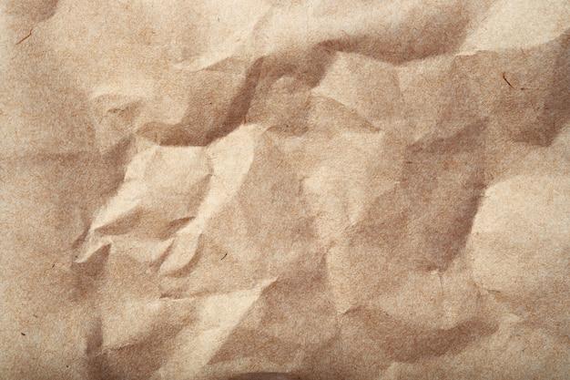Crumpled beige paper texture