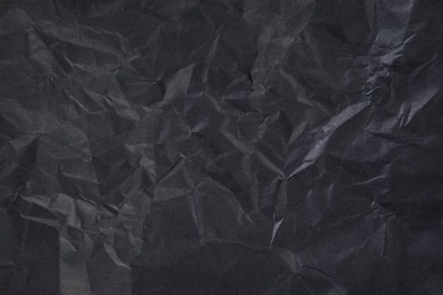 Crumpled black paper as scene. dark tone