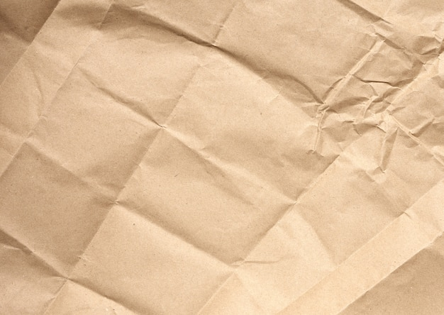 Crumpled blank sheet of brown wrapping kraft paper