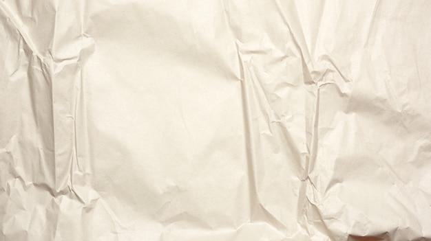 灰色のラッピングクラフト紙のしわくちゃの空白シート、デザイナーのためのテクスチャ