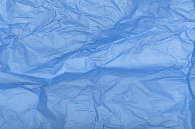 Crumpled blue paper texture as a background.