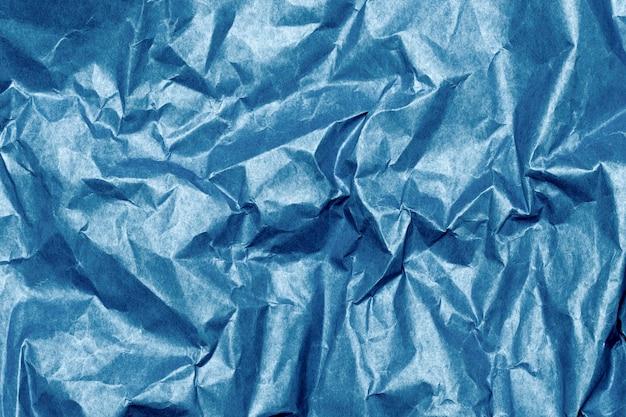 しわくちゃの青い紙のテクスチャ背景