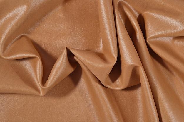 Мятая коричневая ткань